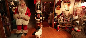 Scott Serafin dresses up like Santa in his Christmas-decorated home
